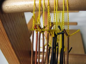 Top of warp ends tied to the nylon yarn.