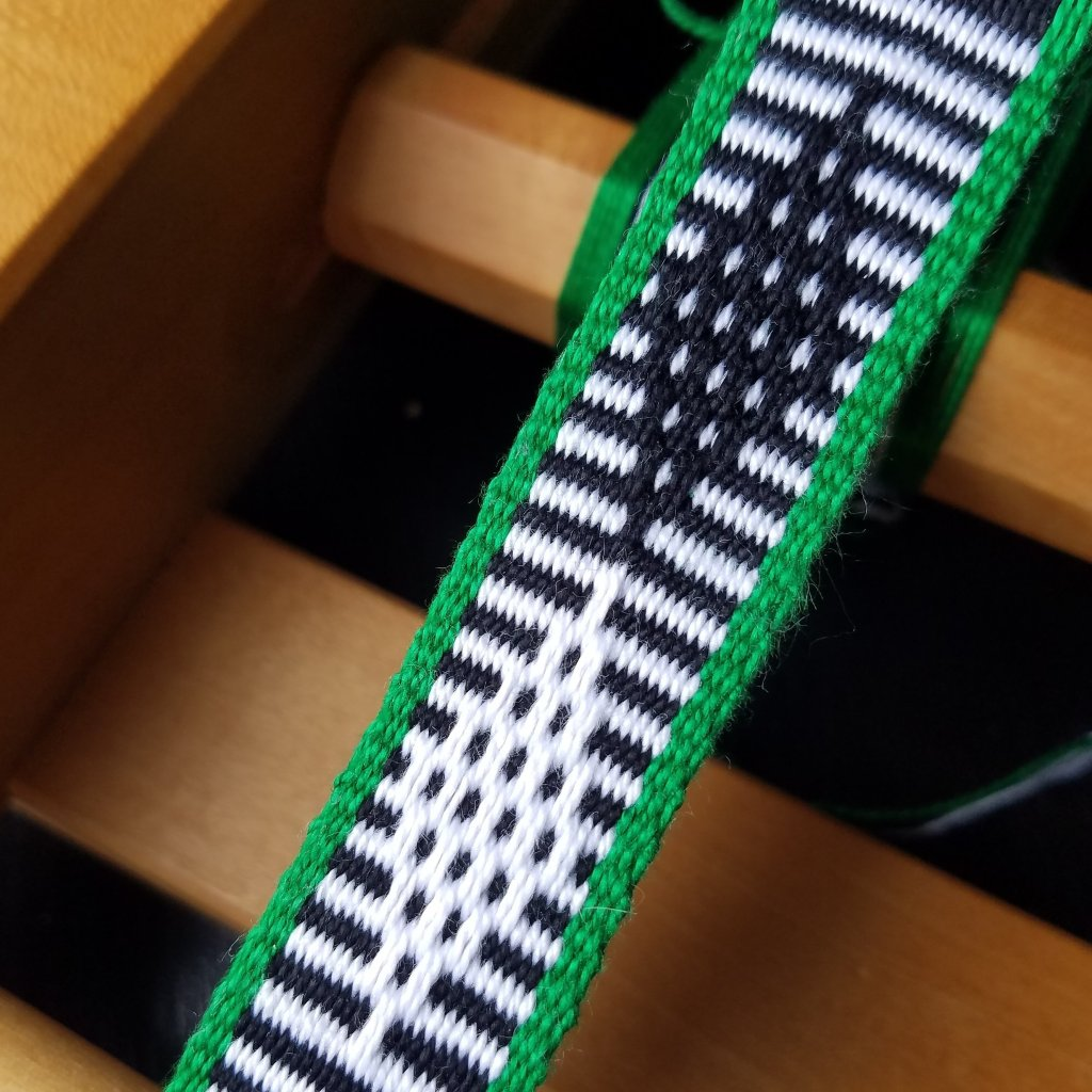 Day 3: page 25 from Inkle by Evelyn Neher.  Uses 2 warp ends at each pick-up.